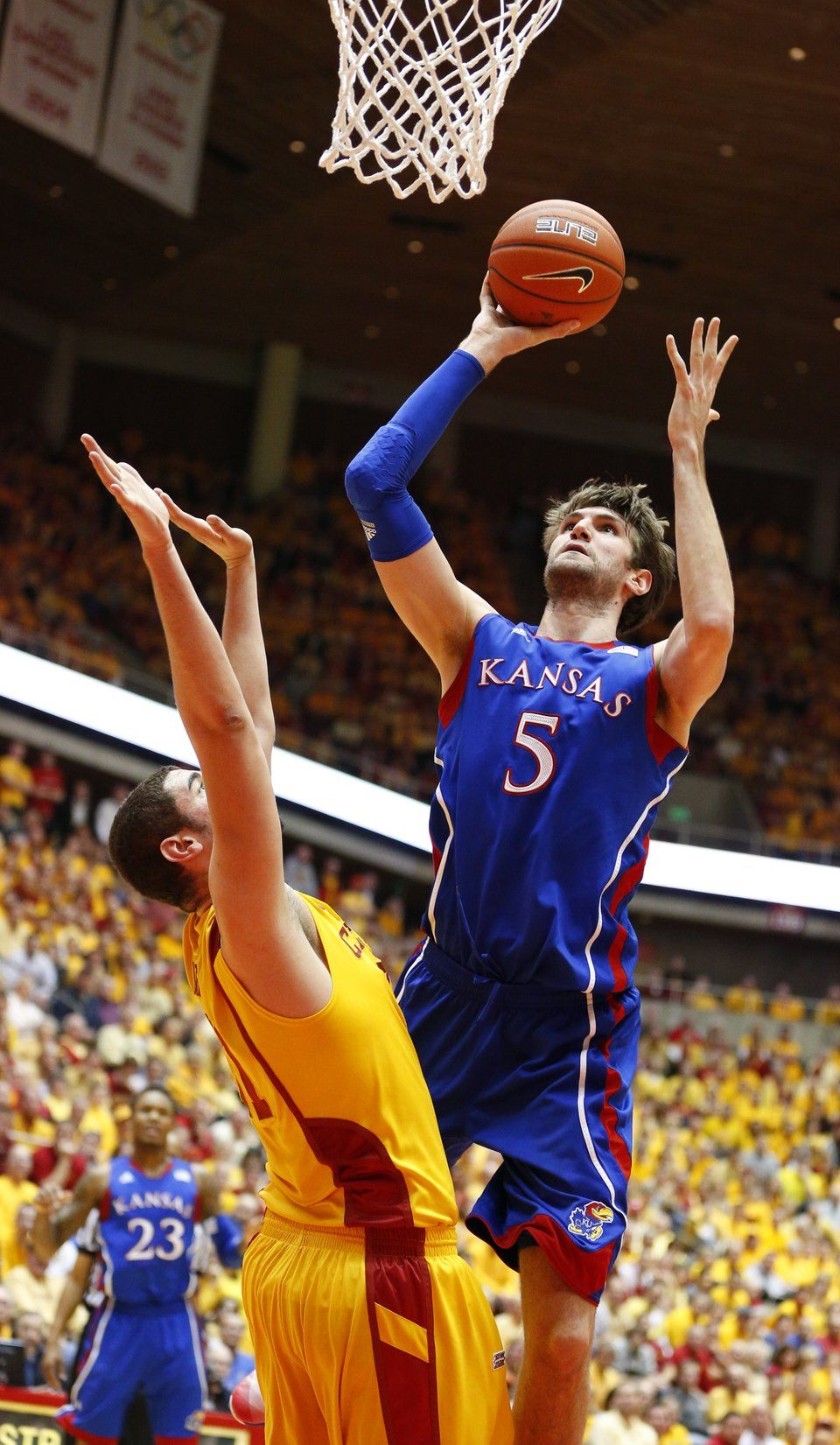 Kansas center Jeff Withey puts up a bucket over Iowa State