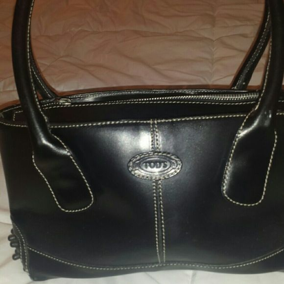 Tods purse Black leather Tod s bag. Awesome condition and a very sturdy bag.  Tod s Bags 3bd364725ebe2
