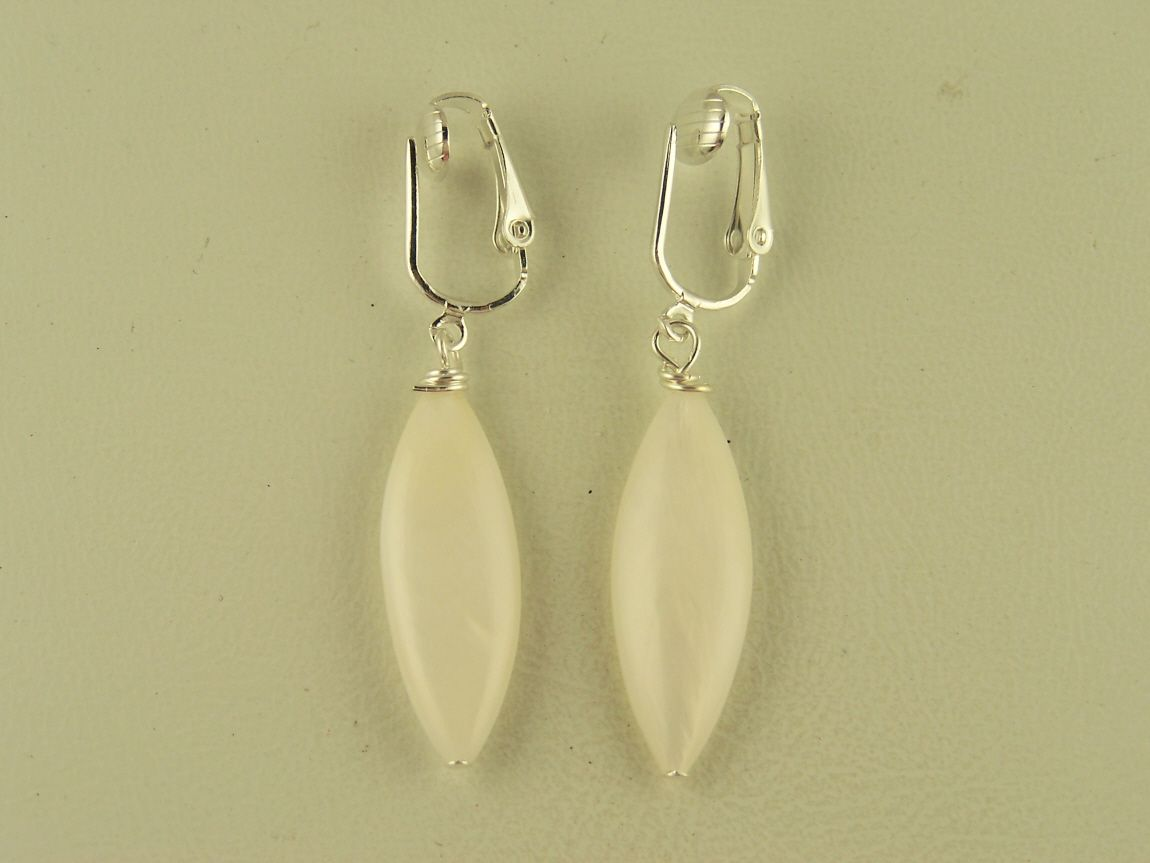 Sleek white mother of pearl shell clip on earrings from www.thecliponearringstore.com