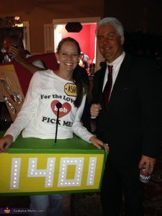 Ashlie: My husband and I dressed up as The Price is Right. I was the contestant and my husband was Bob Barker. I used colored duct tape to cover the box....