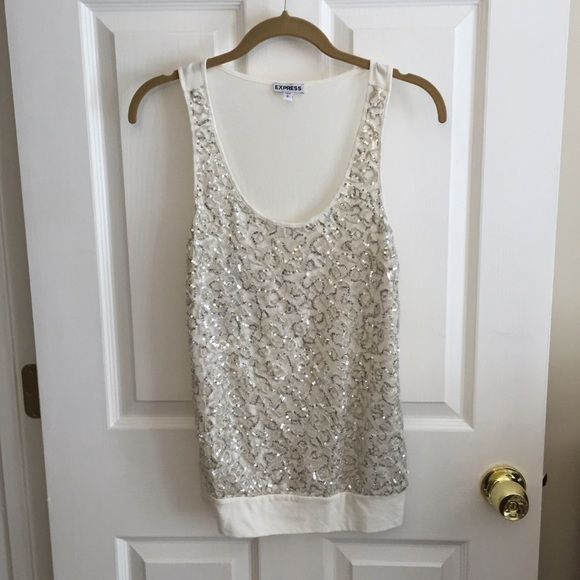 Express Sequin Ivory Tank Small NWOT Never worn. Purchased from Express but I impulsively remove tags when I buy things. ☺️ Smoke free home. I have a cat but he doesn't wear my clothes.  I will consider bundles if you're interested in multiple items but prefer to do them manually after experiences with flippers (buying to resell for a profit). Please don't ask my lowest, use the offer button to submit a reasonable, fair price. ❤️ NO TRADES. Express Tops Tank Tops