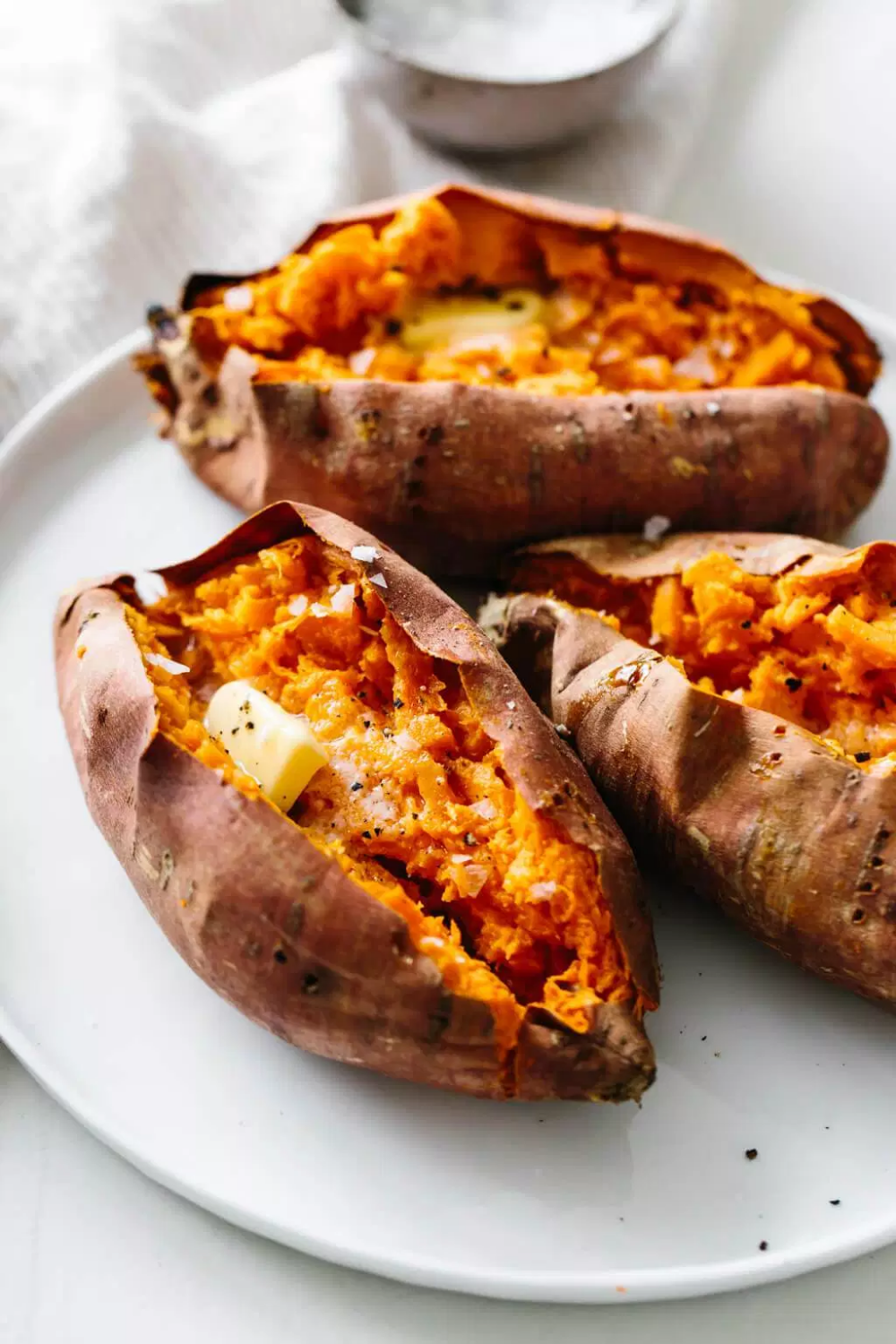 Baked Sweet Potato How To Bake Sweet Potatoes Perfectly Downshiftology Cooking Sweet Potatoes Sweet Potato Recipes Roasted Sweet Potato Recipes