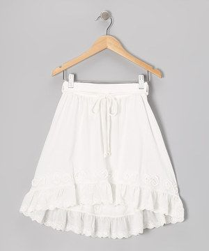 Eyelet and frill bring the best out of this skirt. Simple to slip on, it has a tie around the elastic waistband and a hi-low hem that's contemporary yet classic on little girls.