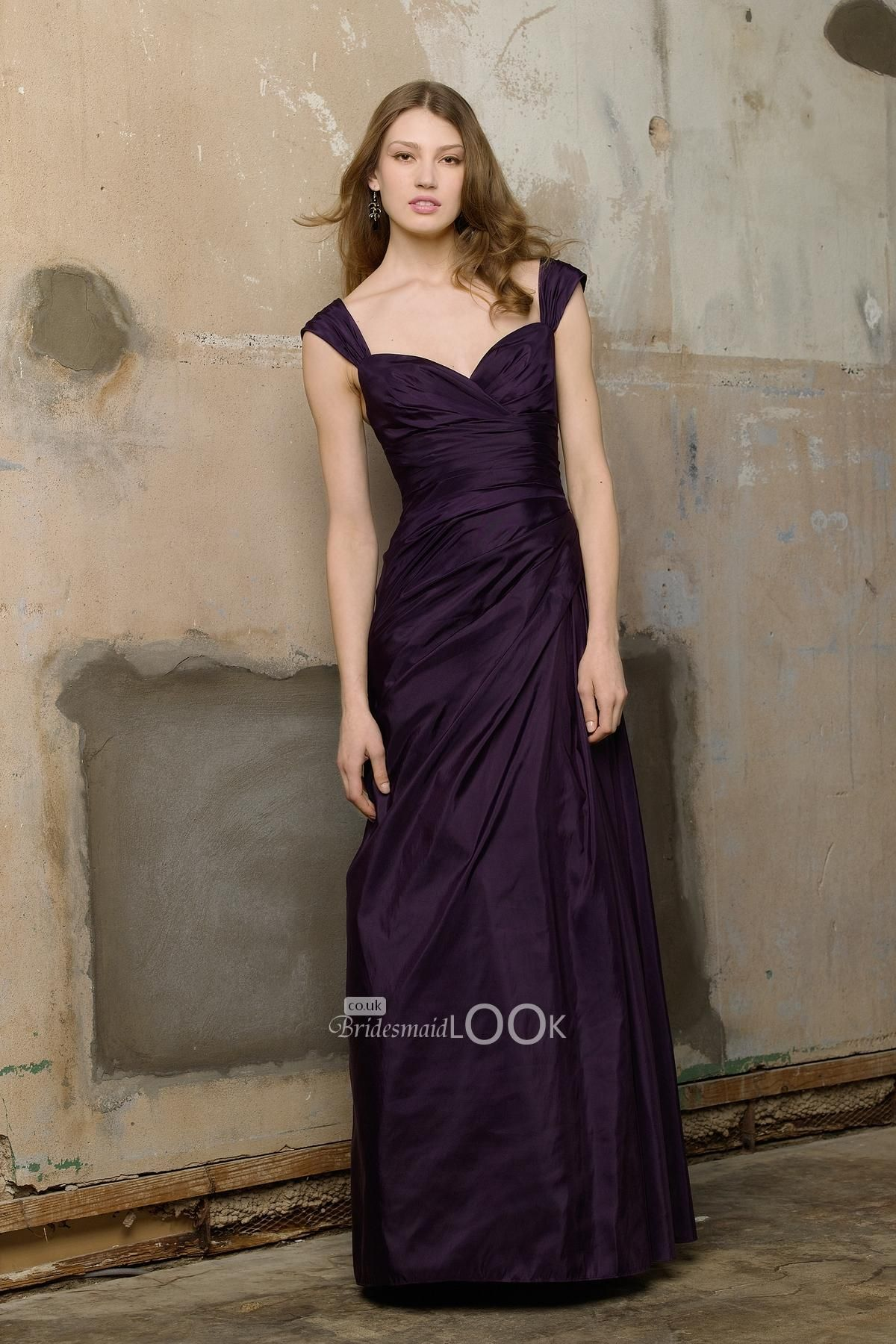 Taffeta plum bridesmaid dress with shirred wide straps and long