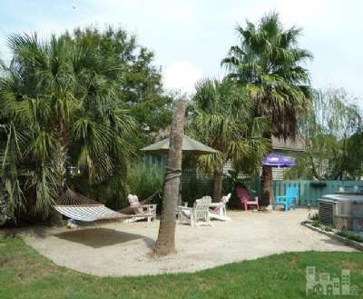 Check Out This Backyard Private Beach Oasis Complete With Tiki Bar And Landscaping
