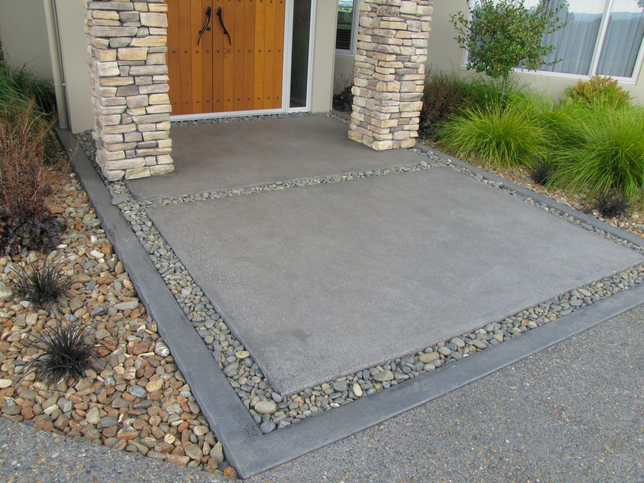 Exposed aggregate driveway with charcoal coloured for Cement driveway ideas