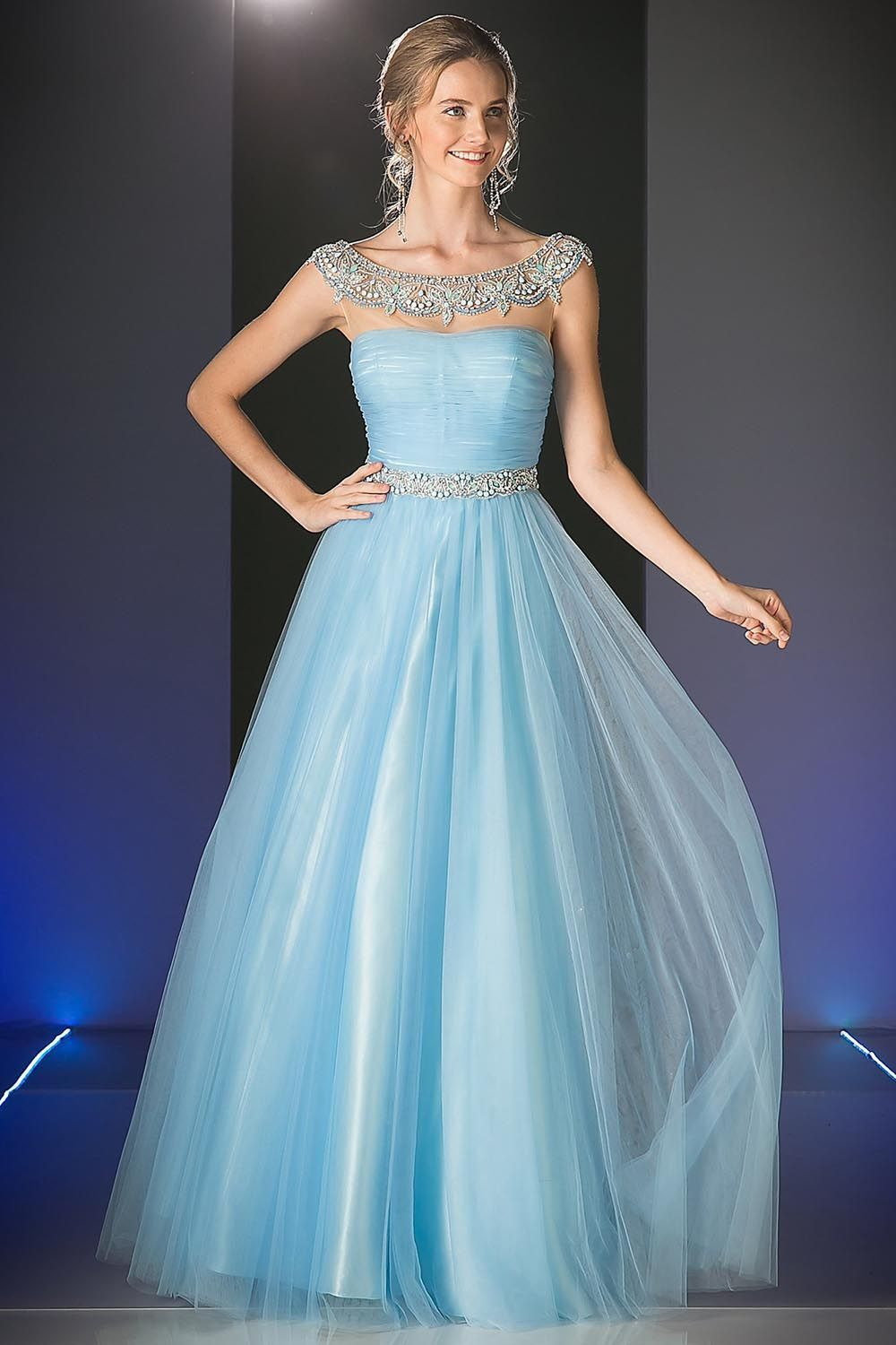 A floor length sleeveless party dress with a tightly ruched bodice ...