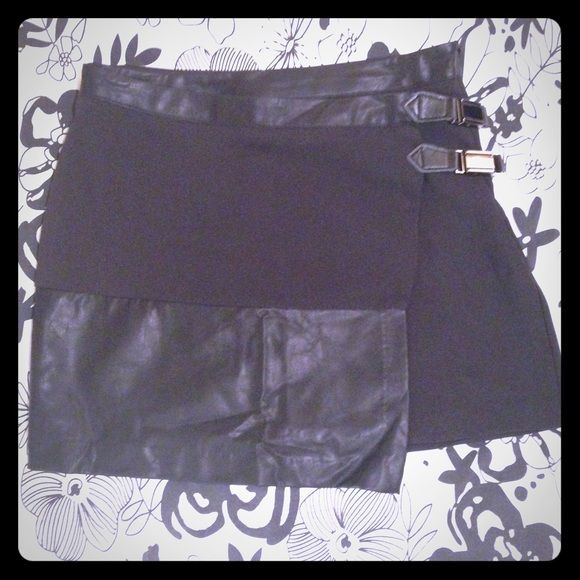 """Jimmy Yoo Skirt Another Australian Favorite. Asymmetrical black skirt. Faux leather. Hidden side zipper. Two from side clasps. NWT. 65% cotton 35% polyester. 15"""" length. Australian size 8 US equivalent size 2/4 or S Jimmy Yoo Fashion  Skirts Mini"""