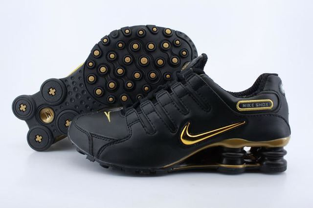 645094af519f Mens Nike Shox NZ Black Gold Logo Shoes