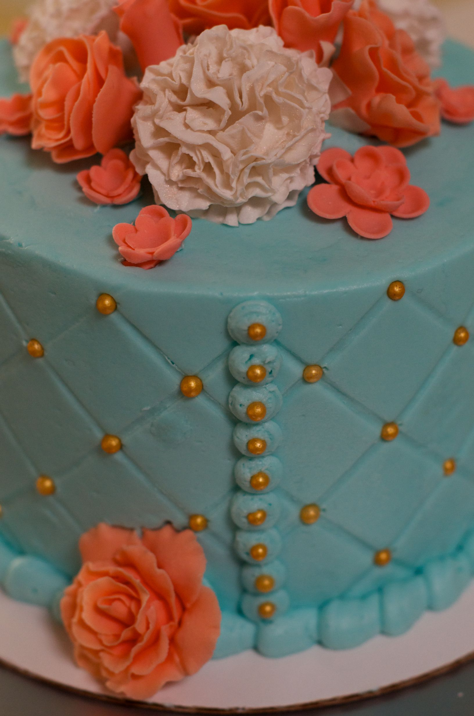 Tiffany blue and coral birthday cake buttercream with gum paste