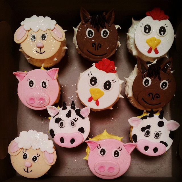Wicked Chocolate cupcakes iced in luf luf butter icing decorated with 2D fondant Farm animal faces - sheep, pigs, cows, horses, chickens by Charly's Bakery, via Flickr