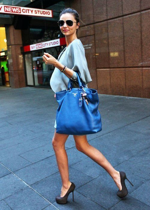 Miranda Kerr can do no wrong. Blue bag.  Charming Charlie Bag