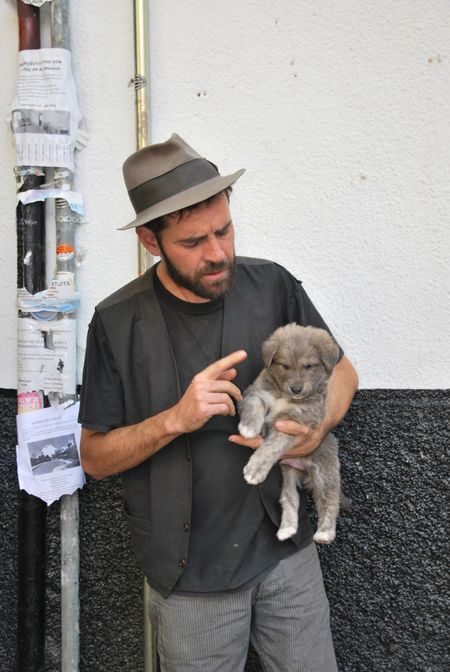 Gypsy with his puppy in Granada, Andalusia, Spain. --Bad Dog by Sophia Wilson