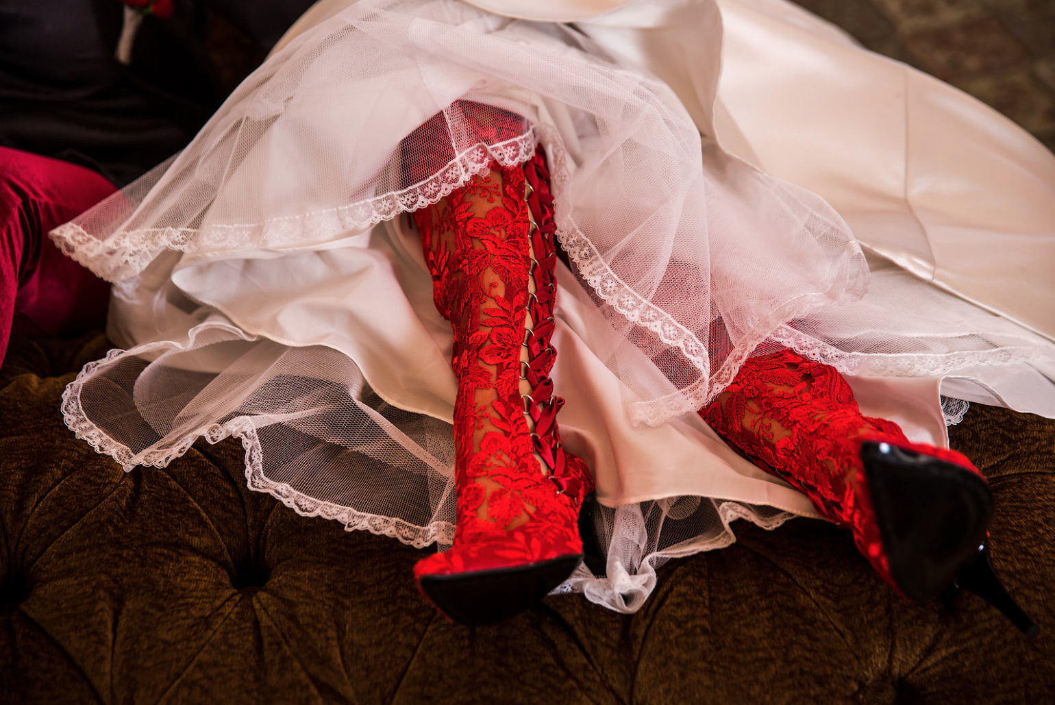 Real House of Elliot bride Misty wore our red Goodnight Sweetheart lace wedding boots for her marriage to Tammy!