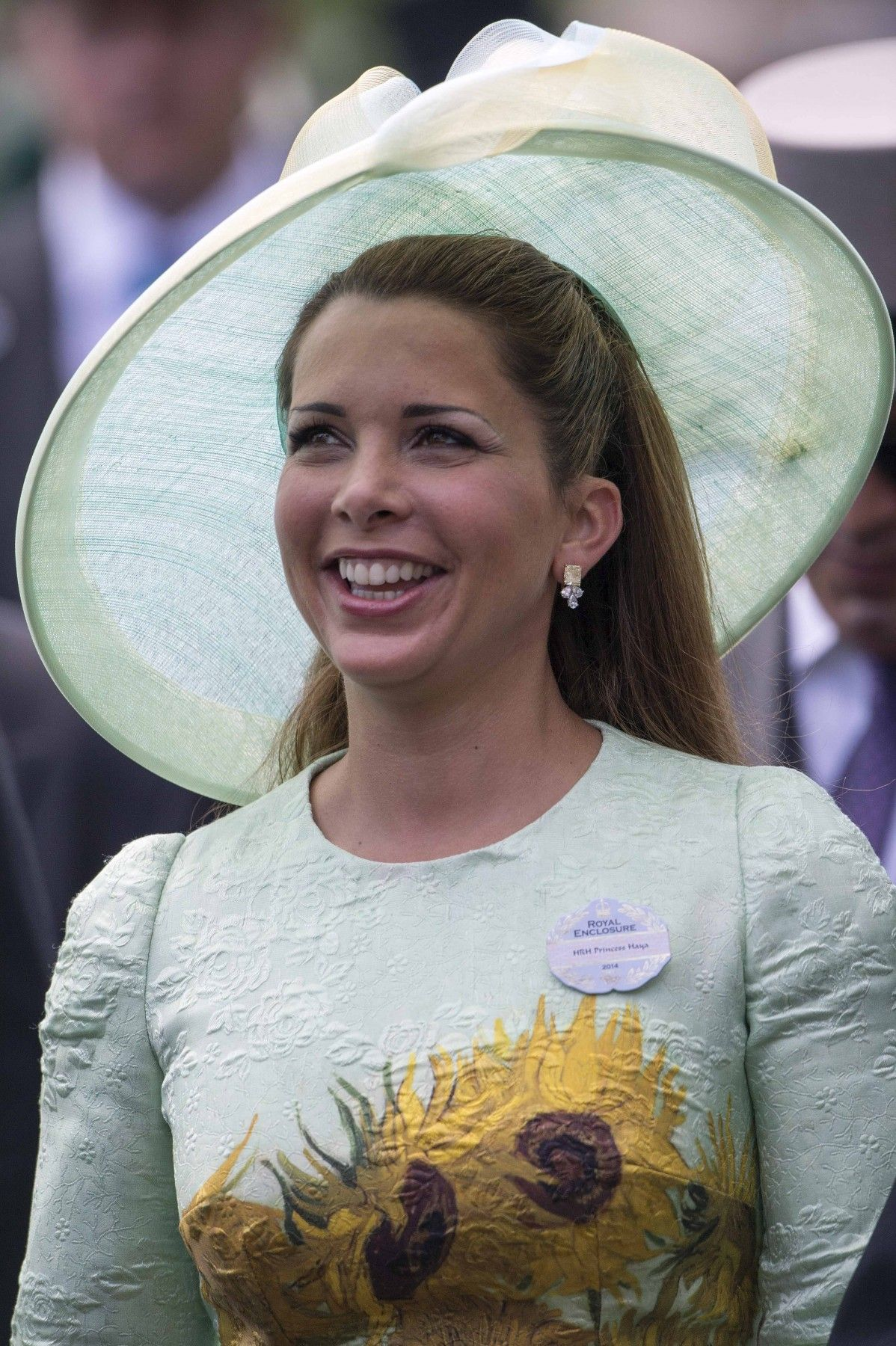 Princess Haya in a very special blue dress with Picasso-like sunflowers on it.