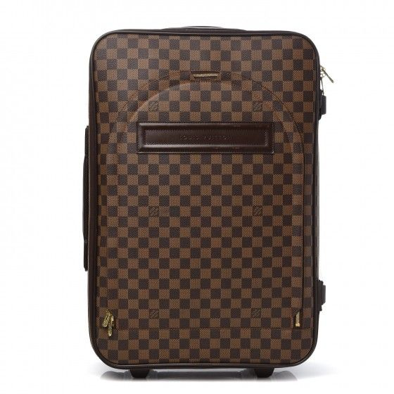 a037efbe1758 This is an authentic LOUIS VUITTON Damier Ebene Pegase 60. This stylish  suitcase is finely