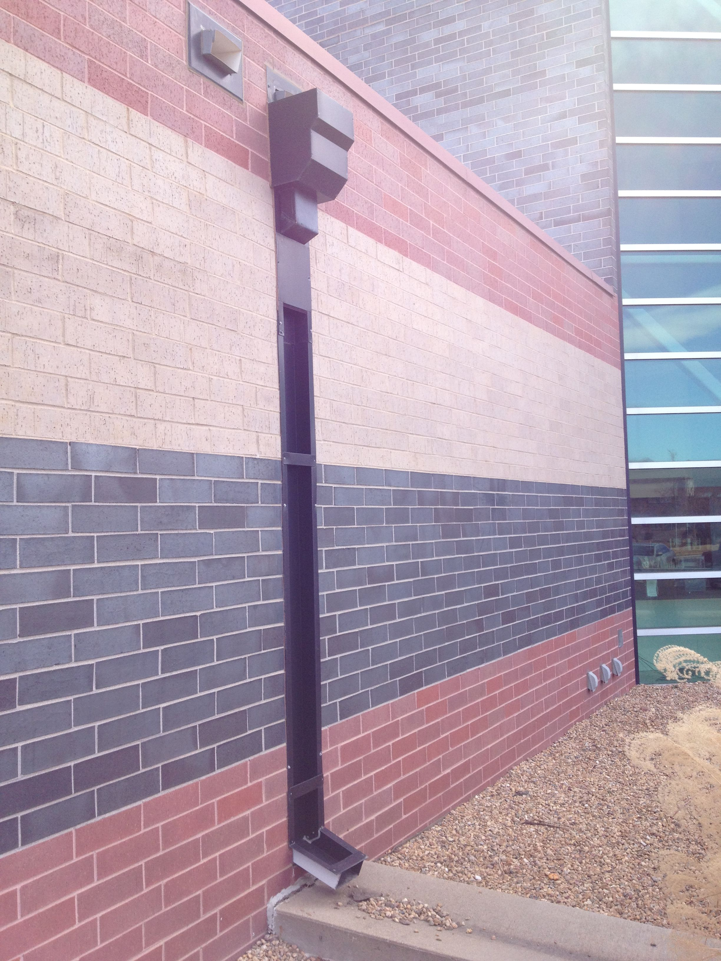 How Downspout Conveying Rain Water To Ground For Garden