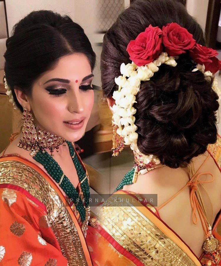 What A Beautiful Large Braided Low Bun With Real Flower Gajra Care However Should Be Taken Before Wedding Bun Hairstyles Bridal Hairdo Indian Bride Hairstyle
