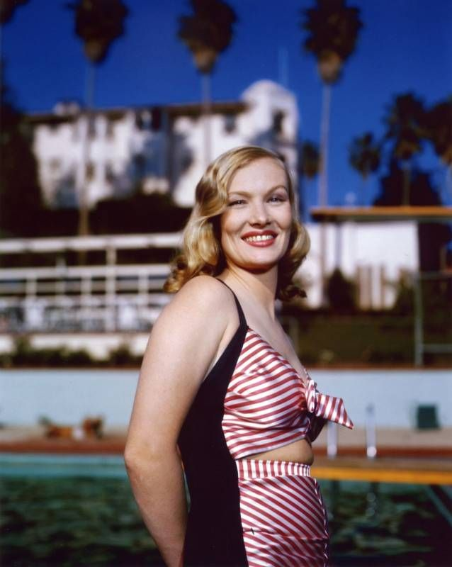 Veronica Lake In A Striped Swimsuit Standing Poolside At