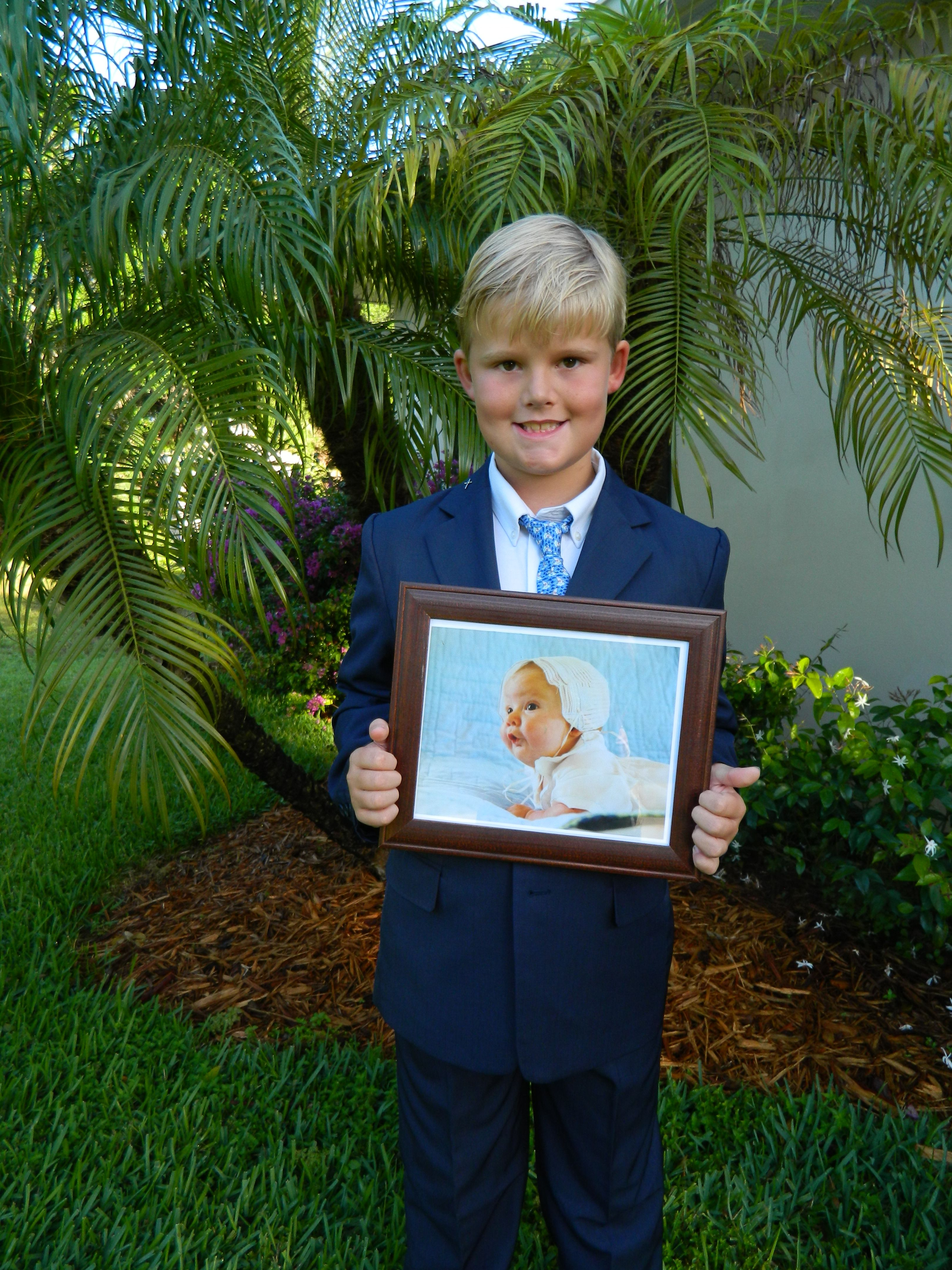 First Holy Communion Picture Holding Picture From Baptism
