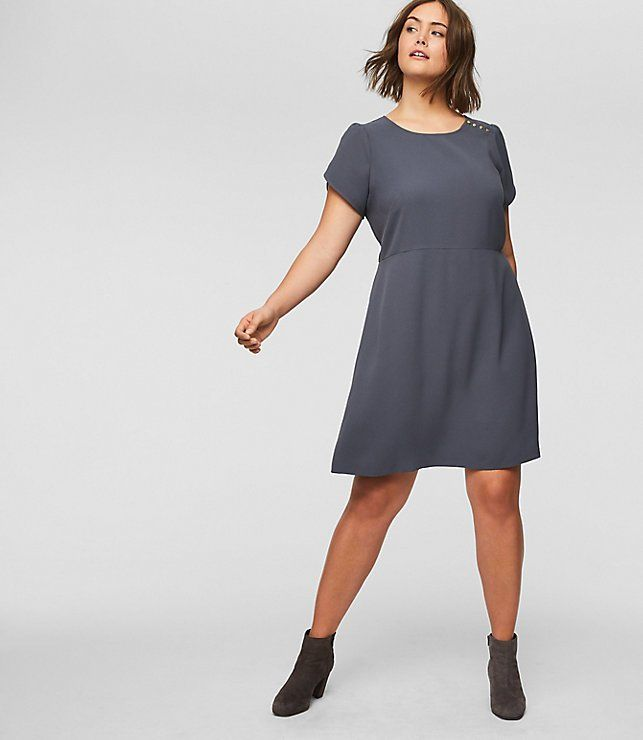 Polished shoulder buttons and femme puff sleeves give all the right moves to this flattering flare dress