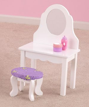Little ones are sure to love primping and pampering darling dollies with this vanity and stool set. It features a safety mirror and a stool decked out in pretty purple butterfly fabric.