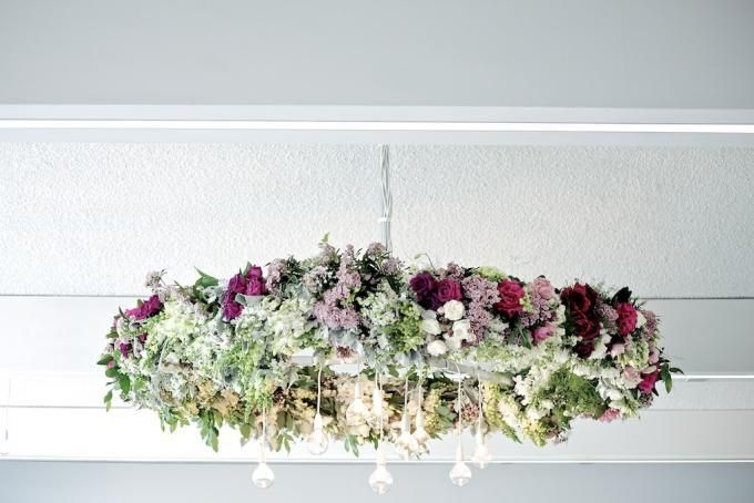 Flower wreath hanging above a wedding table