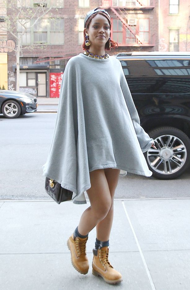 Rihanna in a grey poncho and Timberland boots