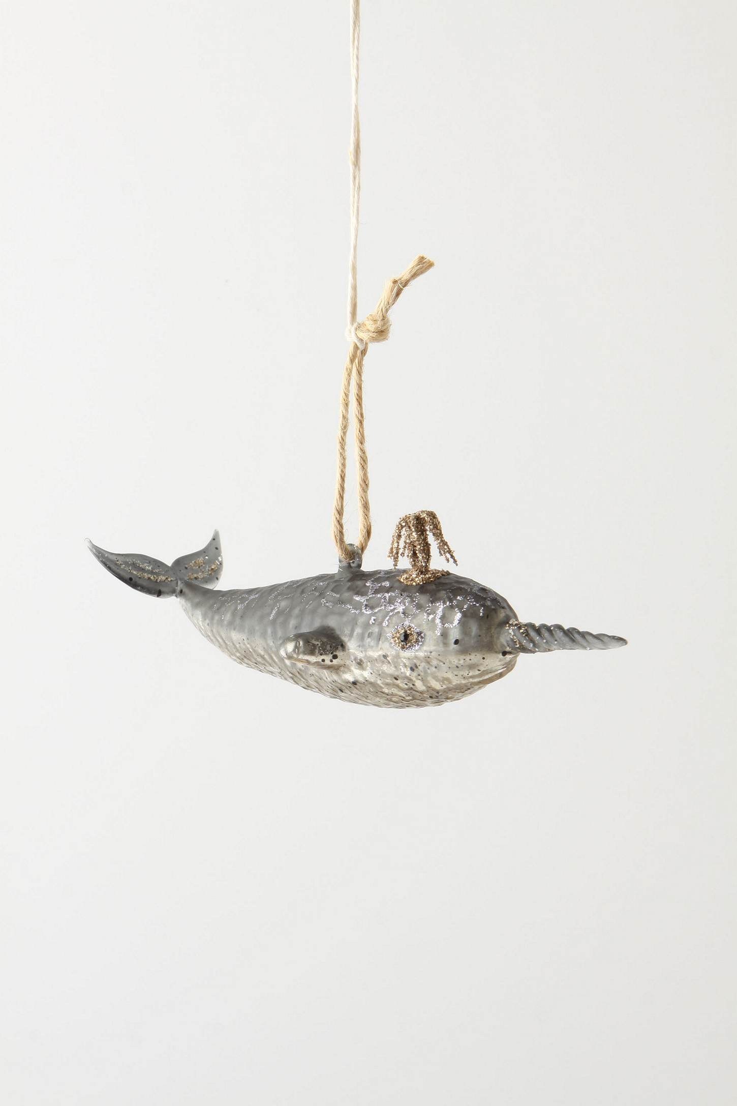 love this narwhal christmas ornament with its glitter spout