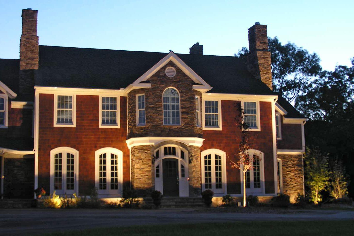 Outdoor lighting shouldn 39 t make your house look like a runway uplight the facade to add night for House exterior lights