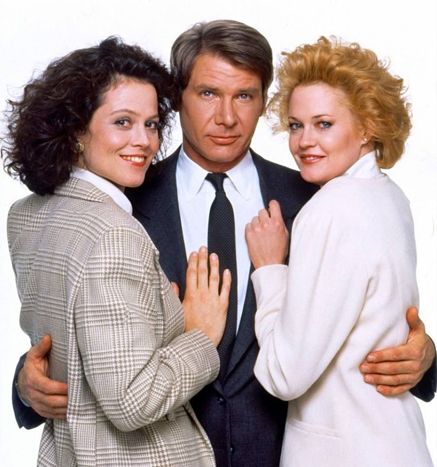 Melanie Griffith as Tess McGill, Sigourney Weaver as Katharine Parker and Harrison Ford as Jack Trainer in Working Girl a 1988 romantic comedy film written by Kevin Wade and directed by Mike Nichols.
