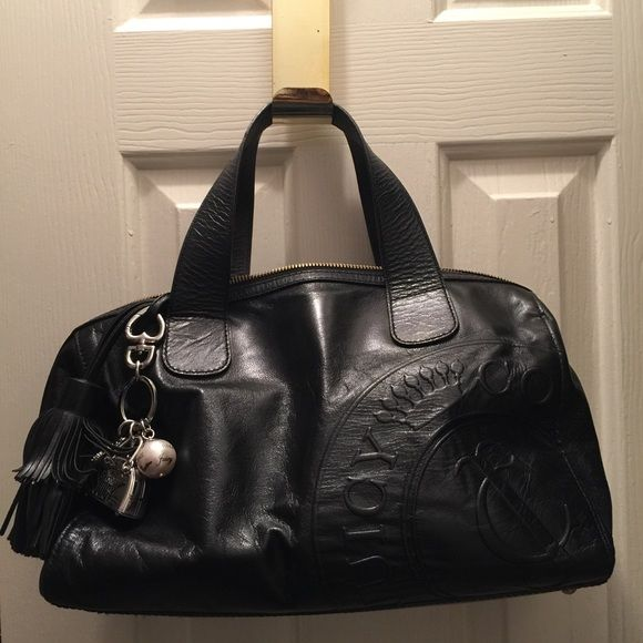 Purse Black Juicy purse,  has a stain  and a tear inside but it's still in ok condition. Has a dust bag. Juicy Couture Bags Totes