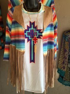 Beautiful faux suede vest with serape cross on back. Perfect with any of our serape sleeve t's. Grab yours before it's gone! Classy Cowgirl Co- Gypsy Cowgirl ,F