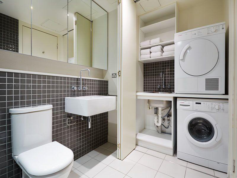 Flush Folding Doors Concealing Laundry Laundry In Bathroom House Rental Laundry Storage