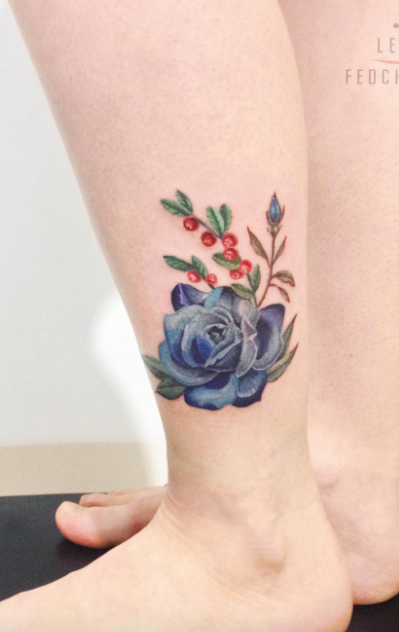 f7a721fcbcf9c Beautiful Blue Rose Tattoo. Find this Pin and more on Rose Tattoos by  InkStyleMag.