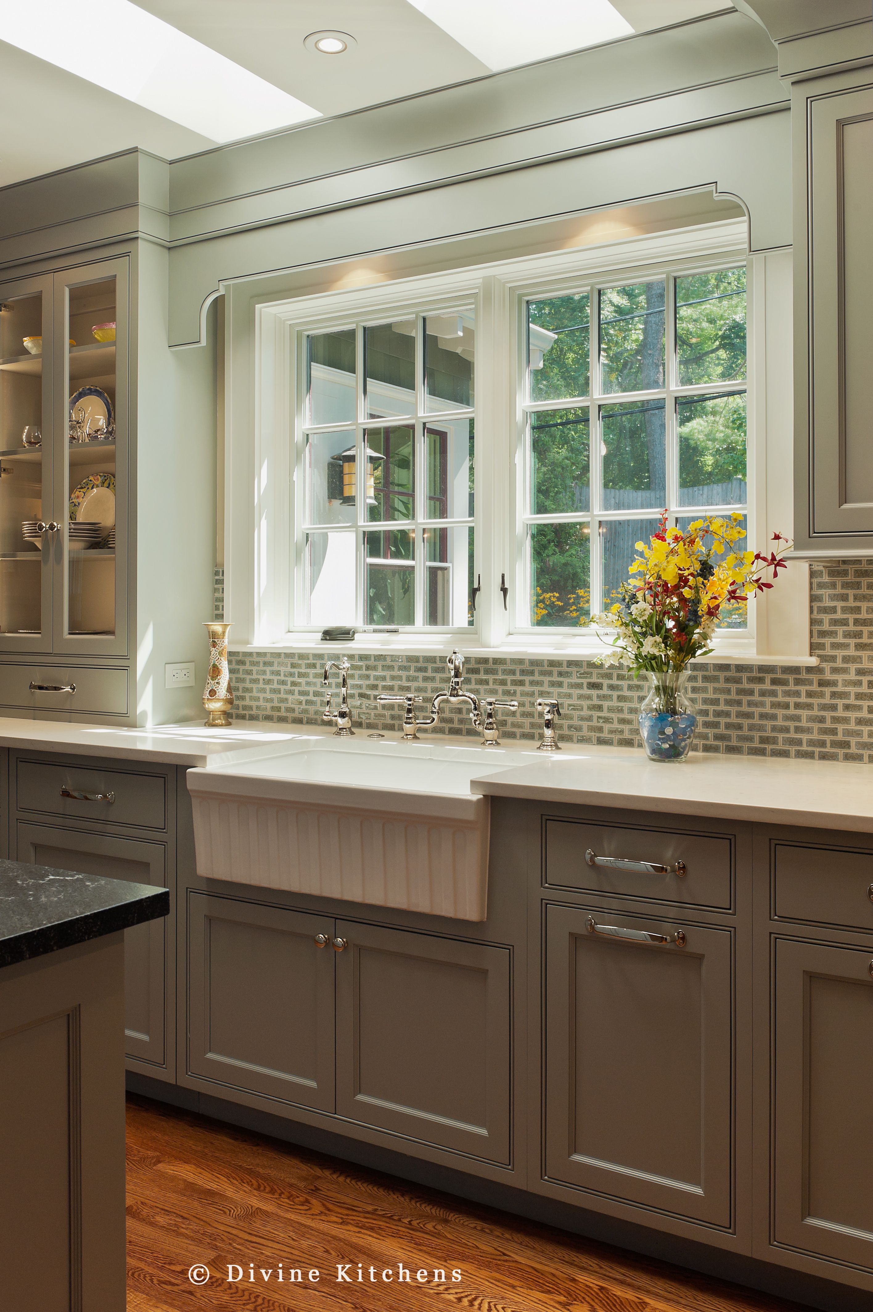 Gray white countertops and a farmhouse sink =