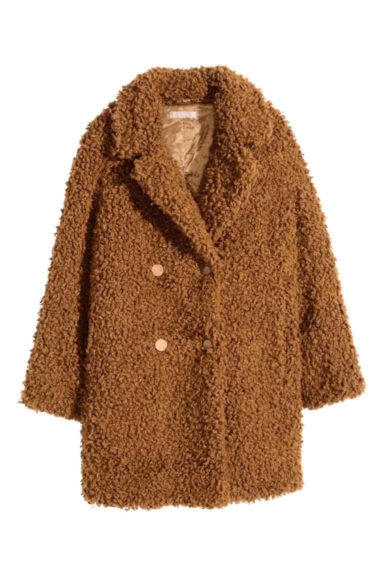 teddy jas: een jas van teddy met een dubbele rij gladde knopen van