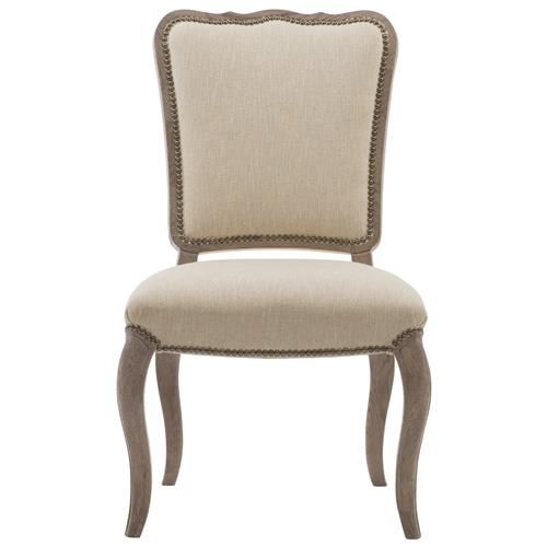 This lovely linen dining chair adds French Country charm to any space. The curved, white oak wood frame has an antique feel and naturally complements the ivory beige upholstery. A sophisticated compromise between formal and casual dining.