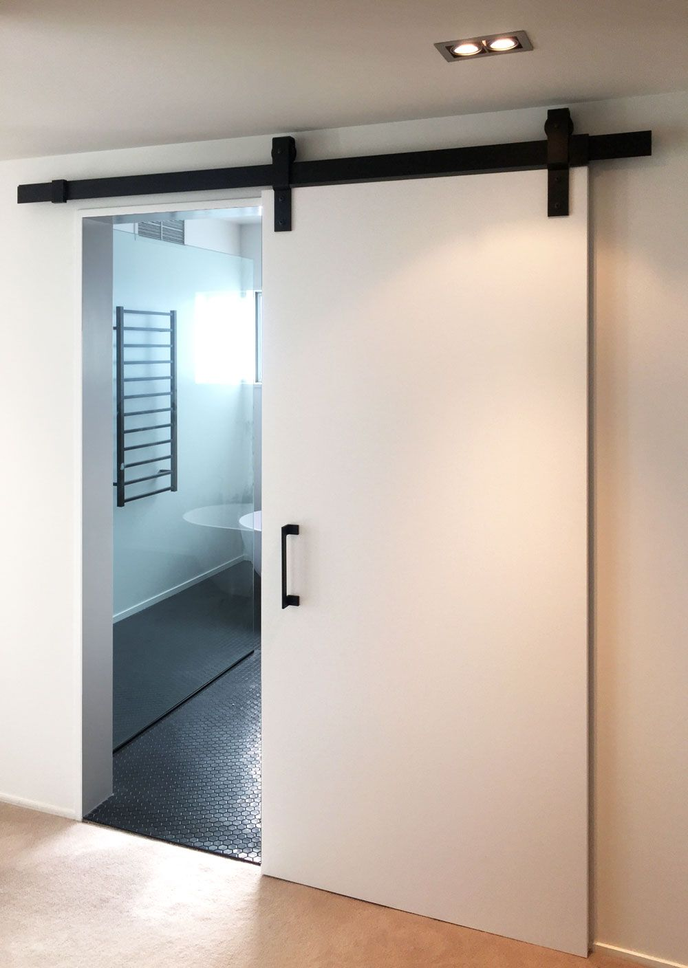 Cavity Sliders Black Anodized Barn Door Track With White Door This Barn Door Track Is Equipped With Soft Close Soft Op Barn Door Track Barn Door White Doors