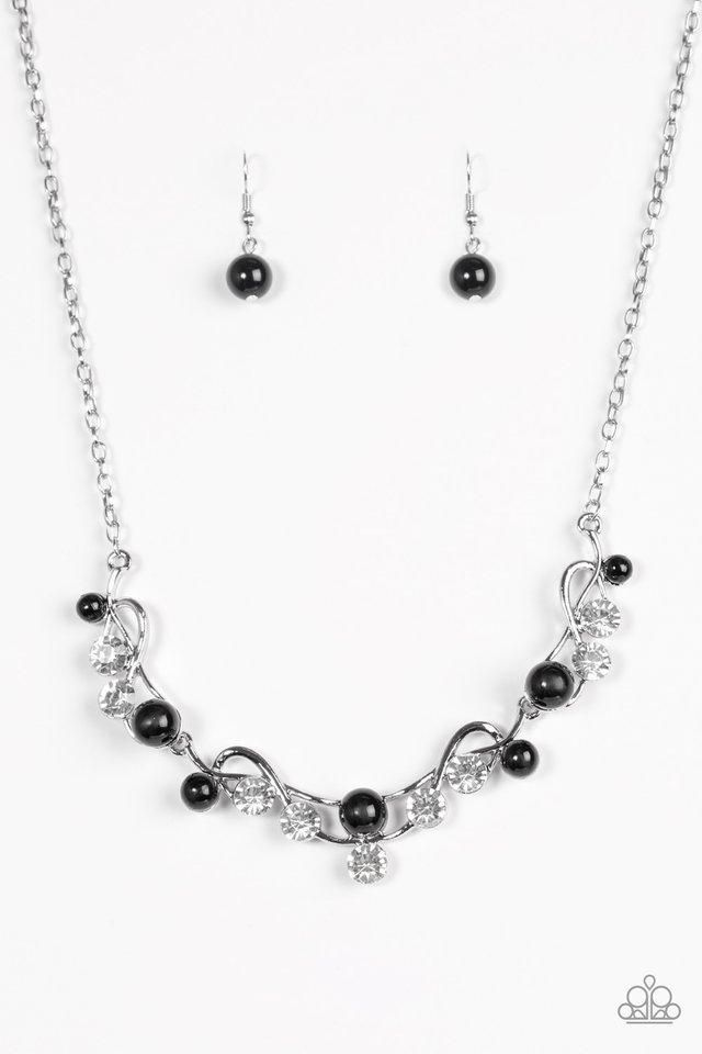 Dramatic white rhinestones and classic black beads are sprinkled across the  swooping frames for a timeless finish. Features an adjustable clasp ... 28234dd387b1