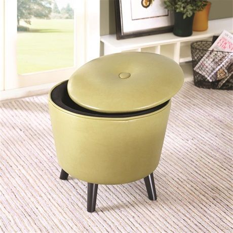 This mid century, button tufted round ottoman offers storage ...