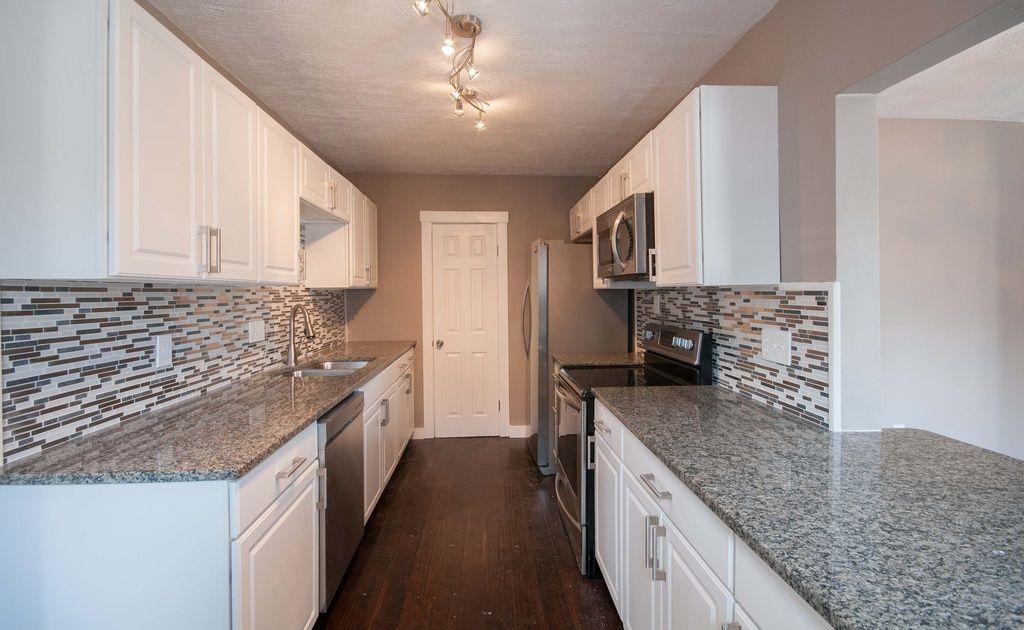 Contemporary Kitchen With Flush Light, Raised Panel, SenSa Caledonia Granite  Kitchen Countertop, Simple