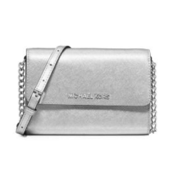 e64f1d5be323 Michael Kors Jet Set Travel Crossbody Silver Metallic Michael Kors Crossbody.  Perfect for someone who travels a lot and doesn't want to tote around a  huge ...