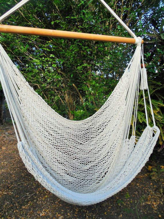 Large hammock chair made with cotton and wood materials  Perfect for a good rest or gift  Can be used in gardens, rooms, living room, terraces, etc.  Capacity: 105 kg.