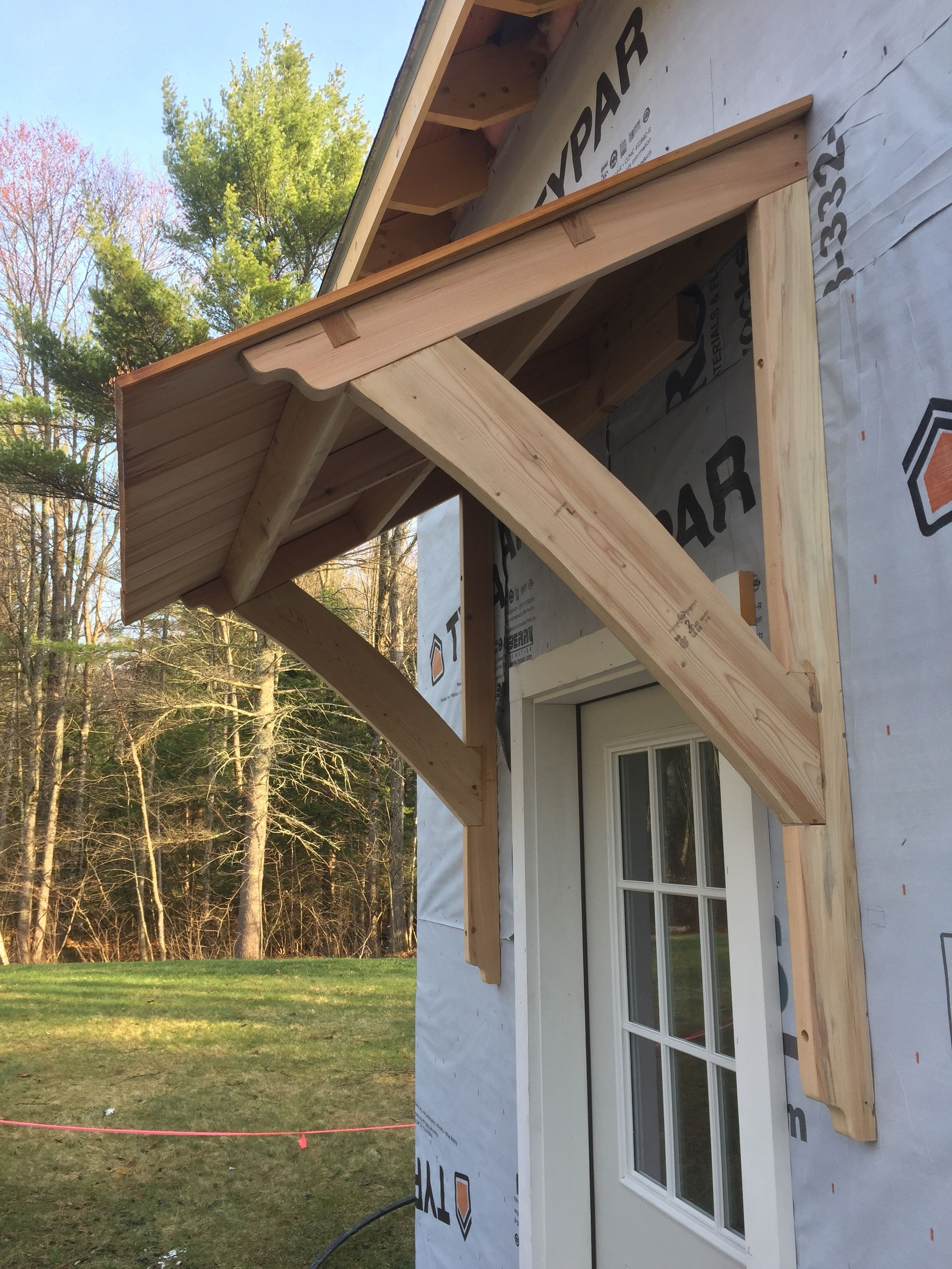 how to build a porch roof over door