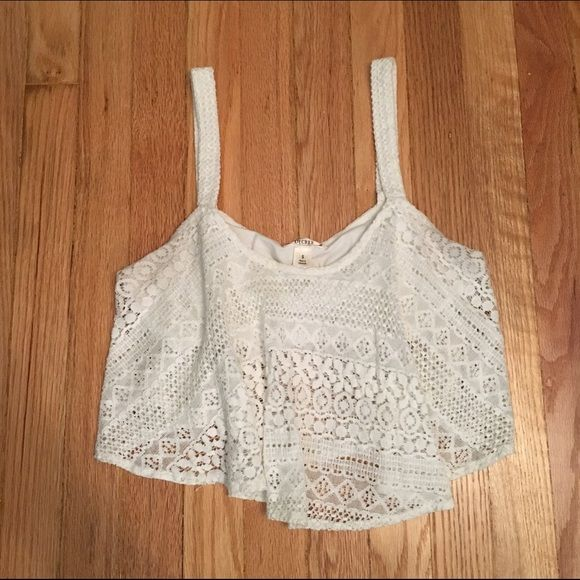 White Lace Crop Top Beautiful lace crop top!! There is a cami underneath to easily hide a strapless bra. Decree Tops Crop Tops