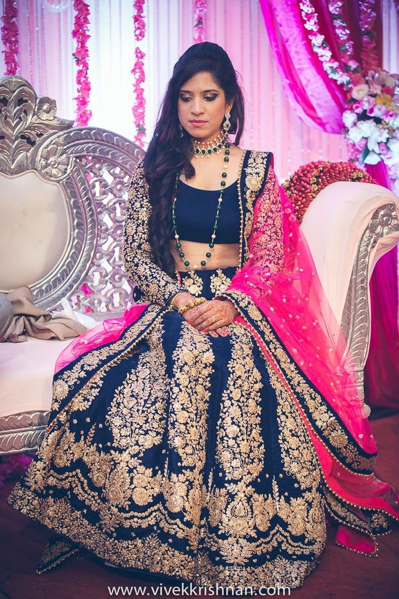 9ffb6324c5 A navy blue lehenga with a fuchsia dupatta for the sangeet ceremony ...