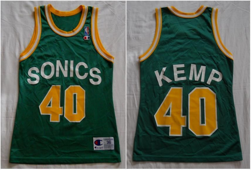 66a7ee21ff9 Vintage early 90s Seattle Supersonics Shawn Kemp Jersey by Champion. Men's  36/Small (pre-owned)