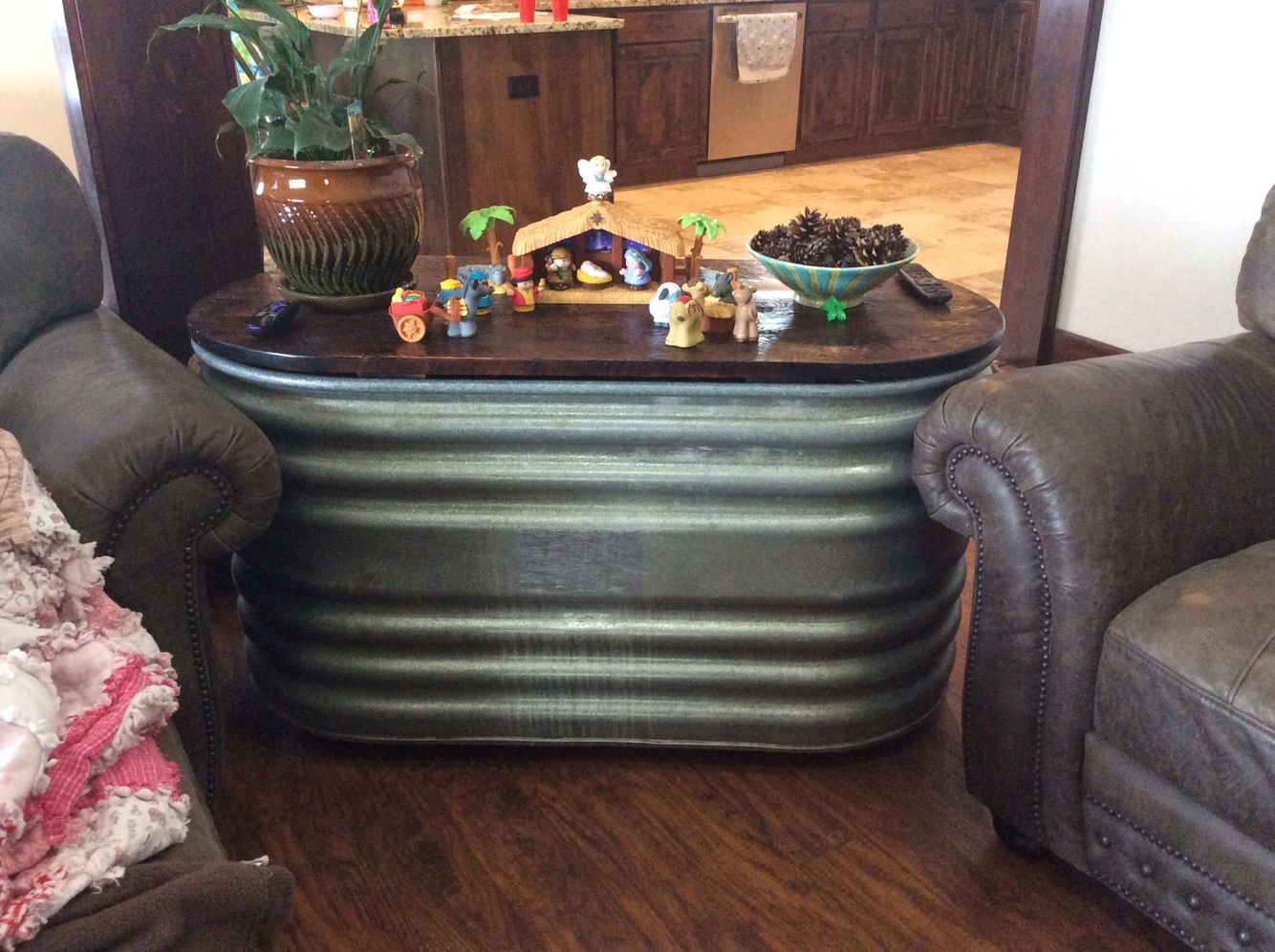 Stock tank living room table with storage for girls toys
