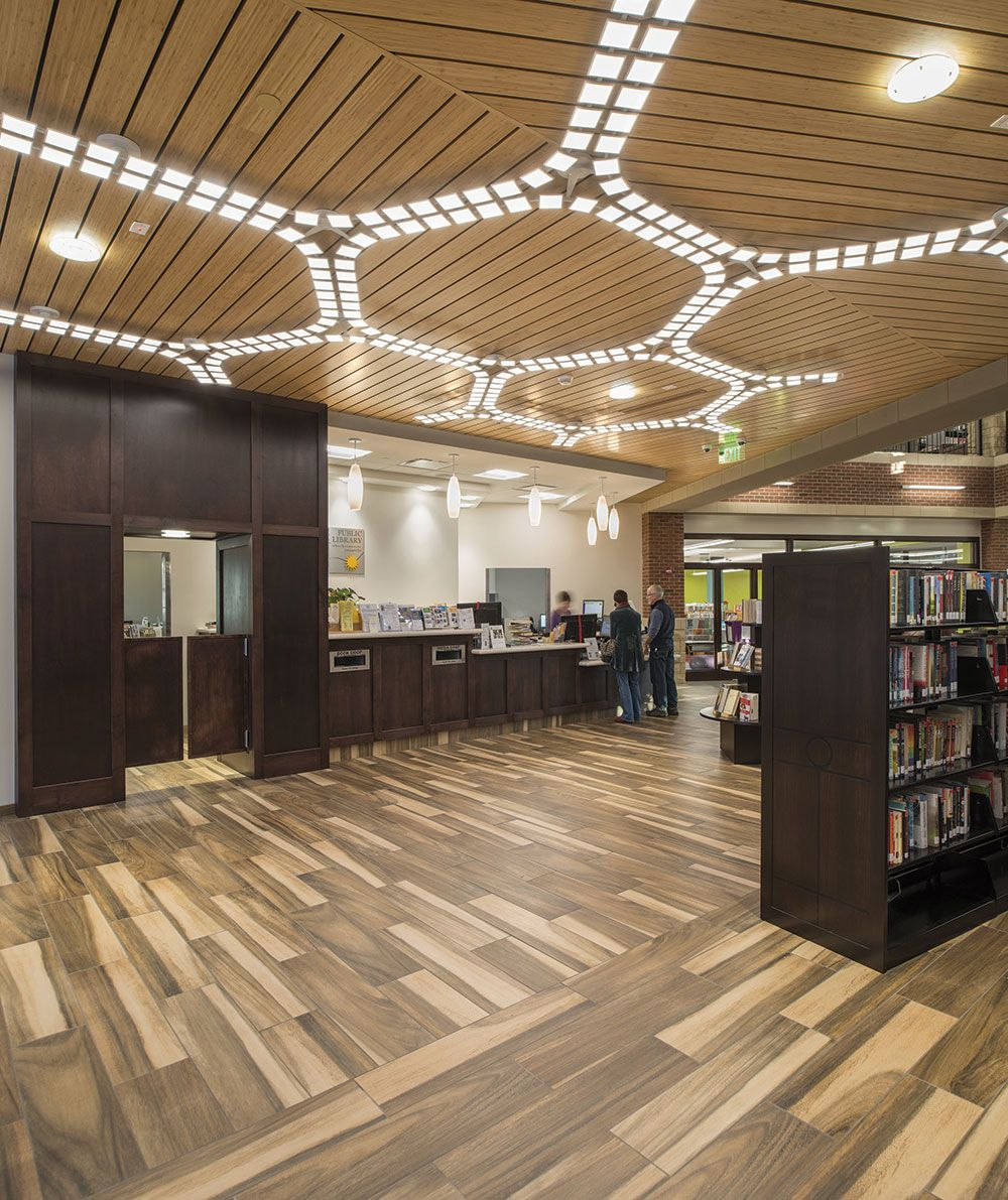 An oled lighting application at irondequoit library in rochester n y uses acuitys trilia ceiling fixtures